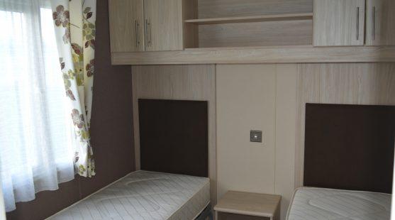 Twin bedroom of Delta Glade 2013 Caravan at Moss Wood Caravan Park
