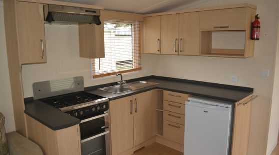 Kitchen of Swift Bordeaux 2011 Caravan at Moss Wood Caravan Park