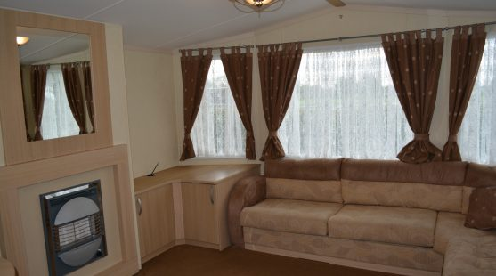 Living room of Swift Burgundy 2008 Caravan at Moss Wood Caravan Park